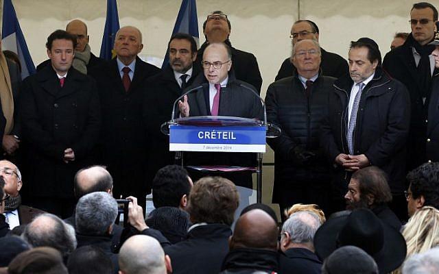 French Interior Minister Bernard Cazeneuve addressing a rally against anti-Semitism in the Paris suburb of Creteil on December 7, 2014. (photo credit: AFP/THOMAS SAMSON)