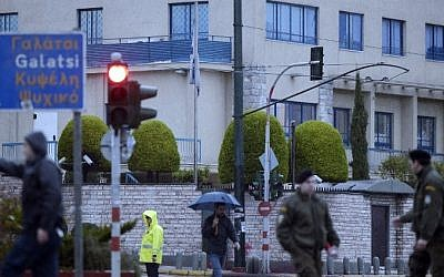 Illustrative: Police gather outside the Israeli embassy building in Athens on December 12, 2014. (AFP/Louisa Gouliamaki)