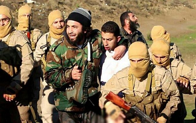A still image released by Islamic State on jihadist websites on December 24, 2014, purportedly shows a Jordanian pilot captured by IS after they shot down a warplane from the US-led coalition near Raqqa, Syria. (photo credit: AFP/HO/Welayat Raqa)
