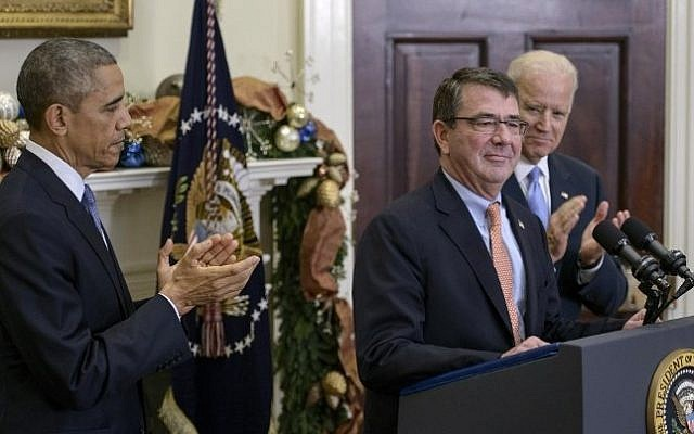 US President Barack Obama (left) and Vice President Joseph Biden (right) with Ashton Carter (center) after nominating him for secretary of defense at the White House on December 5, 2014. (photo credit: AFP/Brendan Smialowski)