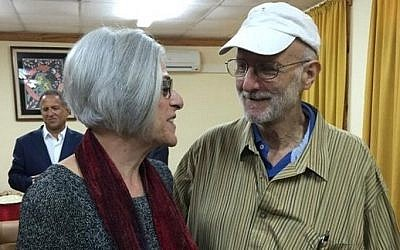 This photo courtesy of the office of US Senator Jeff Flake's (R-AZ) Twitter account, shows Alan Gross and his wife Judith before departing from Cuba on December 17, 2014. (photo credit: AFP PHOTO/JEFF FLAKE/HANDOUT)