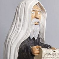 A Jew figurine holding a piece of Torah scroll, Bogusław Suwała, 1980s (photo credit: Grzegorz Mart)