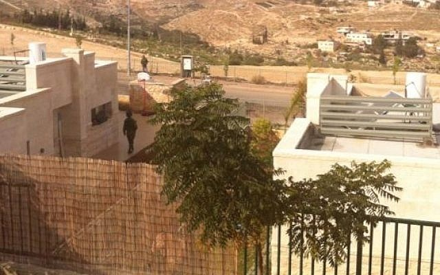 Security forces seen patrolling the settlement of Tekoa after two Palestinian men armed with a knife were detained outside the community, December 9, 2014. (photo credit: Times of Israel)