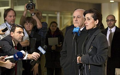 Dina Kawar,  Jordan's UN envoy, accompanied by Palestinian envoy Riyad H. Mansour, speaks to journalists following a meeting of Arab delegations to the UN on a draft Security Council resolution regarding Palestinian statehood on December 29, 2014. (photo credit: Devra Berkowitz/UN)