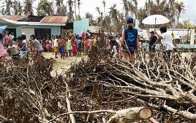 Children and IsraAid volunteers in the Philippines after Typhoon Hagupit wreaked havoc, on December 22, 2014. (photo credit: Courtesy IsraAid)