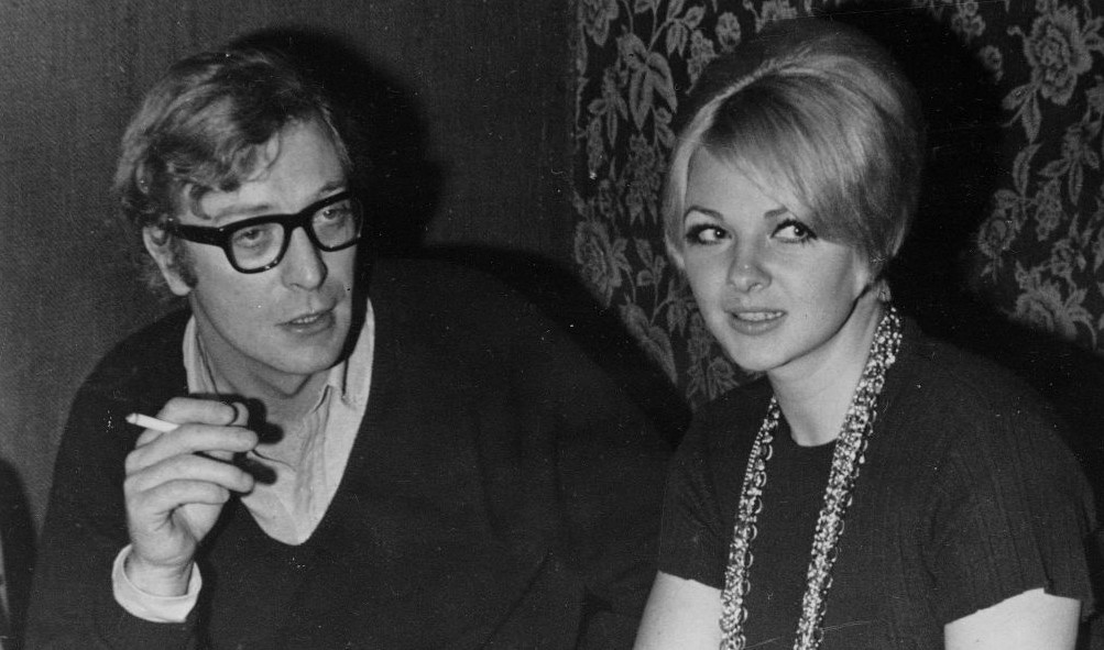 British actor Michael Caine is shown with Mandy Rice-Davies at the discotheque she ran in Tel Aviv, November 1968. (photo credit: AP Photo)