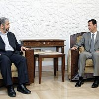 In this picture released by the Syrian national news agency SANA, Syrian President Bashar Assad, right, meets then-Hamas political chief Khaled Mashaal in Damascus, July 3, 2008 (photo credit: AP)