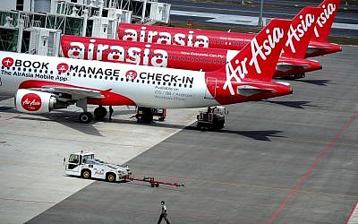 A fleet of AirAsia passenger jets on the tarmac of the new low cost terminal KLIA2 in Sepang, Malaysia, Tuesday, May 13, 2014 (photo credit: AP/Joshua Paul, File)