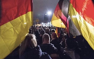 Illustrative image of Germans carrying flags during rally in Dresden, December 15, 2014. (AP/Jens Meyer)