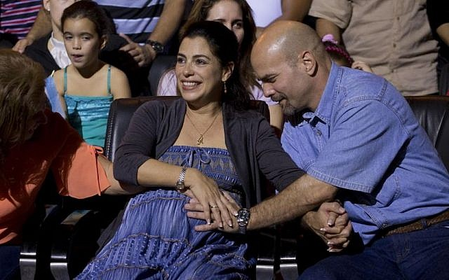 """Gerardo Hernandez, right, member of """"The Cuban Five,"""" touches the belly of his pregnant wife Adriana Perez, during a concert in Havana, Cuba, Saturday, December 20, 2014 (Photo credit: Ramon Espinosa/AP)"""