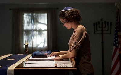 Student rabbi Sara Eiser, visiting from rabbinical school in Cincinnati, Ohio, goes over her notes before a Shabbat service at the Synagogue of the Black Hills in Rapid City, S.D. South Dakota's first Jewish congregation was established in Deadwood more than 150 years ago during the Gold Rush. Today, fewer than 400 people make up the Jewish community in this sparsely populated state of about 845,000 residents. (photo credit: AP Photo/Kristina Barker)