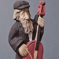 A Jewish figurine playing the cello, 2013 by Andrzej Biela (photo credit: Grzegorz Mart)