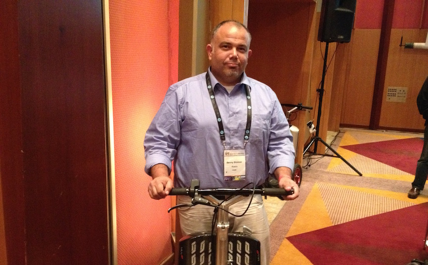 Benny Shimon, CTO of Roadix, stands on a MUVe (Photo credit: Courtesy)