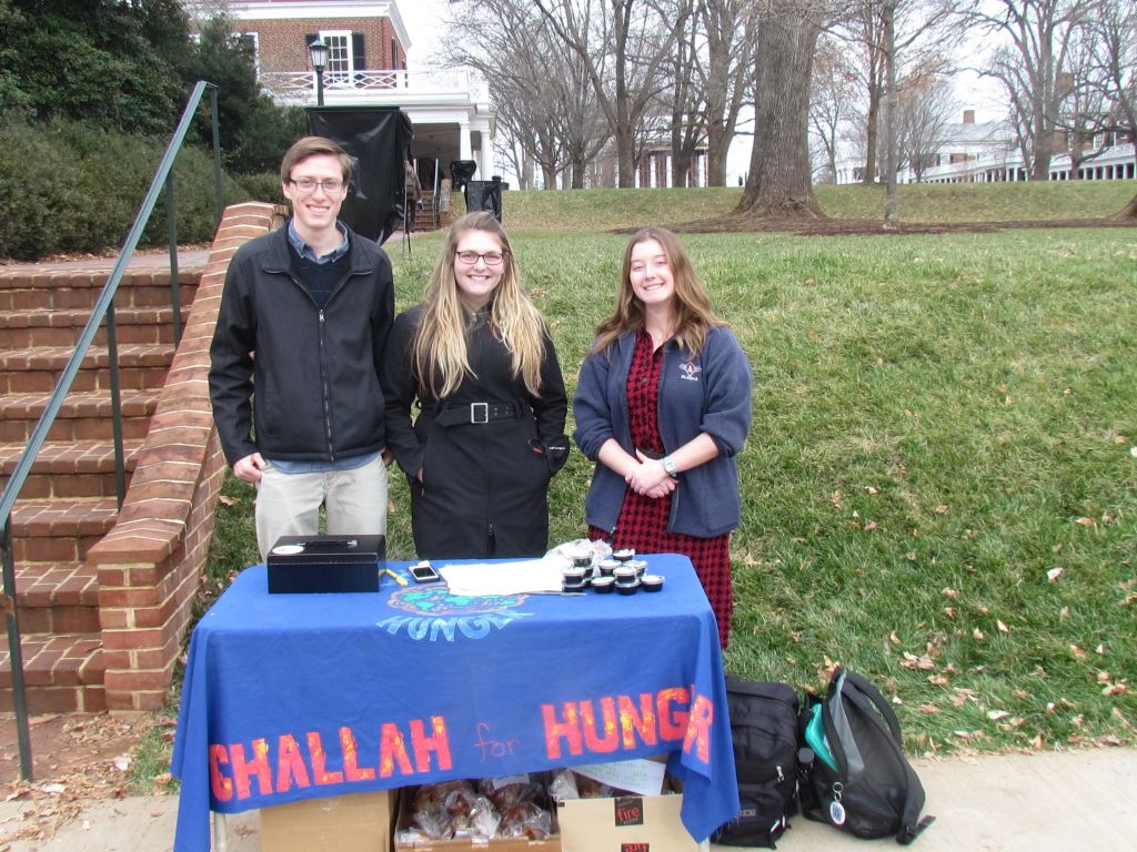 Pierce Eggan, 19, Madison Orlow, 19 and Patricia Garvey, 20, (L-R) volunteer with Challah for Hunger in front of the University of Virginia lawn, designed by Thomas Jefferson, the university's founder on Dec. 4, 2014. (Ron Kampeas/JTA)
