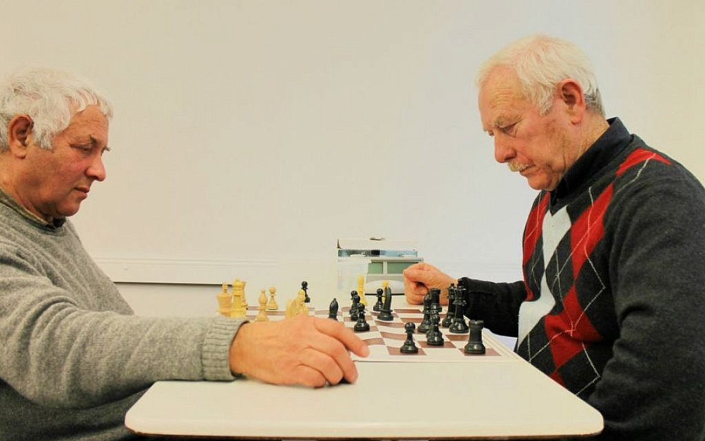 Elderly Russian immigrants play chess at their Makkabi Leipzig Jewish sports club. (Thomas Fritz/The Times of Israel)