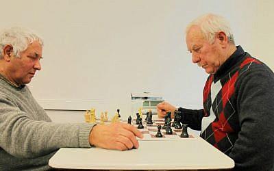 Elderly Russian immigrants play chess at their Makkabi Leipzig Jewish sports club. (Thomas Fritz/The Times of Israel)