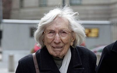 Miriam Moskowitz, 98, leaves federal court in New York on Thursday, Dec. 4, 2014 after a judge rejected her request to erase her 1950 conviction for conspiracy to obstruct justice in the run-up to the atomic spying trial of Julius and Ethel Rosenberg.(photo credit: AP Photo/Richard Drew)