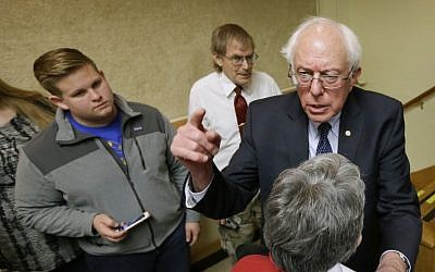 Sen. Bernie Sanders, I-Vt., speaks during a town hall meeting in Ames, Iowa. Sanders says he'll decide by March whether to launch a 2016 presidential campaign. (photo credit: AP/Charlie Neibergall)