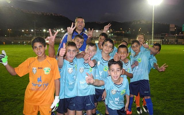 The team from the Druze-Muslim village of Dalat al Karmel before taking the field against a team from the Jewish town of Tirat HaCarmel during Monday's tournament to commemorate the 100th anniversary of the Christmas Truce. (photo: Melanie Lidman/Times of Israel)