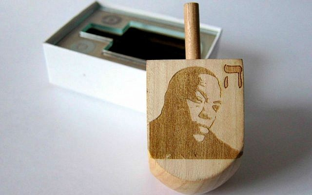 The Dr. Dreidel, a laser-etched wooden dreidel that brings together Hanukkah's traditions with modern times (Courtesy Hannah Rothstein)