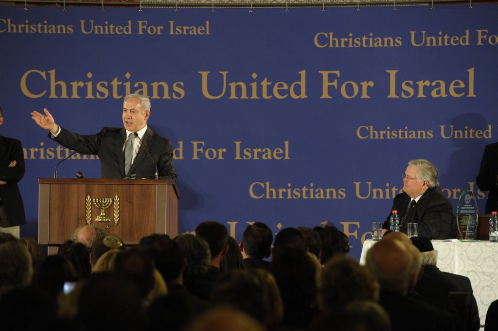 Prime Minister Benjamin Netanyahu speaks to an Evangelical Christian mission of some 800 members of Pastor John Hagee's Christians United for Israel (CUFI) organization, in Jerusalem on March 18 2012. Hagee is at right (Amos Ben Gershom/Flash90)