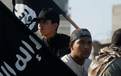 Palestinian demonstrators in Rafah, southern Gaza Strip, hold Islamic State flags as they protest an American film insulting the Prophet Muhammad, September 14, 2012. (Abed Rahim Khatib/Flash90)