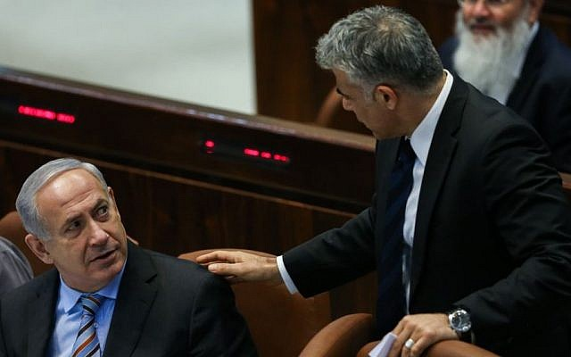 Then-finance minister Yair Lapid with Prime Minister Benjamin Netanyahu in the Knesset in 2013 (Yonatan Sindel/Flash90)