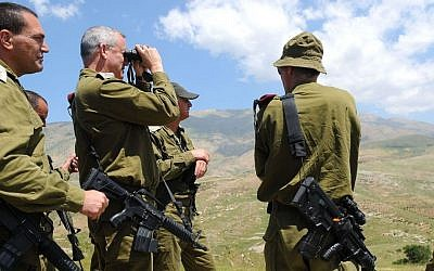 IDF Chief of Staff Benny Gantz uses binoculars as he tours the Israel-Syria border on May 21, 2013. (photo credit: Tal Manor/IDF Spokesman/Flash 90) (illustrative)