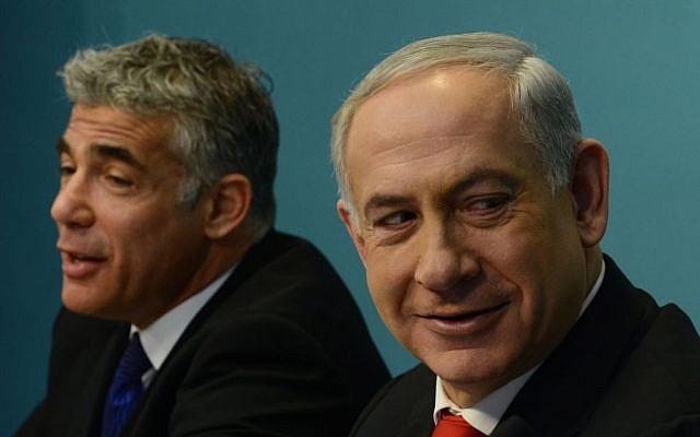 Prime Minister Benjamin Netanyahu and then-finance minister Yair Lapid, July 2013. (Kobi Gideon/GPO/Flash90)
