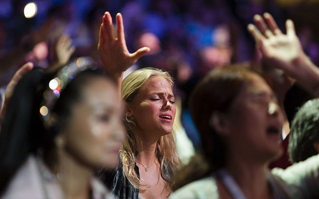 Evangelical Christians from around the world sing and recite prayers at the Jerusalem Chairman's Conference at the International Convention Center in Jerusalem, September 22, 2013. (Flash90)