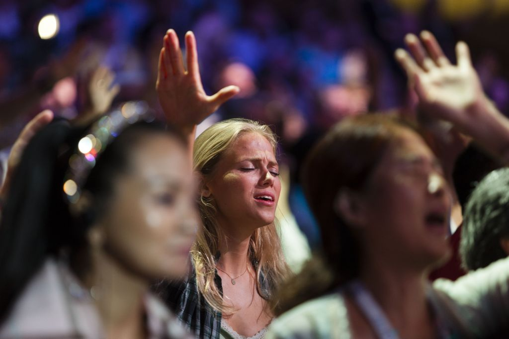 Evangelical Christians from around the world sing and recite prayers as they attend the 2013 Jerusalem Chairman's Conference hosted by the Israel Allies Foundation, at the International Convention Center in Jerusalem, on September 22, 2013. Around 3,000 Evangelical Christians from around the world attended the event, expressing their support for the Jewish state. (Flash 90)