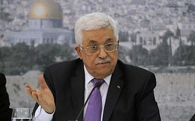 Palestinian Authority President Mahmoud Abbas at his Ramallah office, with an imge of the Temple Mount in the background  (Photo credit: Issam Rimawi/Flash90)