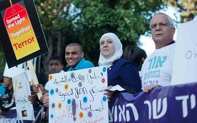 Muslims, Jews and Christians demonstrate against hatred and terrorism outside the Prime Minister's Office in Jerusalem, May 11, 2014. (Photo by Yonatan Sindel/Flash90)