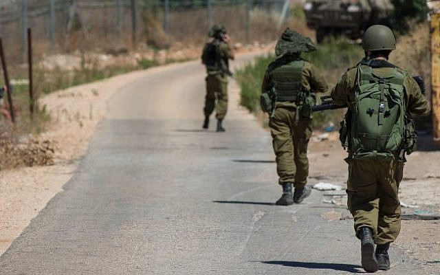 Israeli soldiers patrol along the northern Israeli border with Lebanon on July 18, 2014 (photo credit: Ayal Margolin/FLASH90)