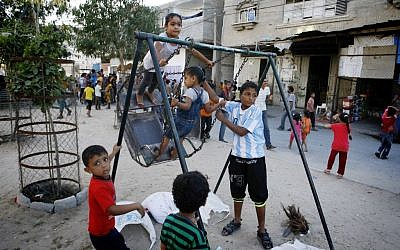 Palestinian children play on a street in Rafah, southern Gaza Strip, October 4, 2014 [photo credit: Abed Rahim Khatib/Flash90]