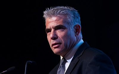 Yesh Atid party leader Yair Lapid speaks at a conference at the David Citadel Hotel in Jerusalem on December 11, 2014 (Miriam Alster/Flash90)