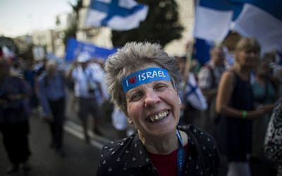 Thousands of Christian Evangelists wave their national flags and march in a Jerusalem parade marking the Feast of the Tabernacles, October 14, 2014. (Yonatan Sindel/Flash90)