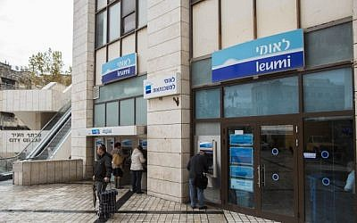 Illustrative image: Israelis walk next to Bank Leumi in Jerusalem on November 16, 2014. (Yonatan Sindel/Flash90)