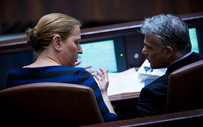 """Justice Minister Tzipi Livni and Finance Minister Yair Lapid during a plenum session on the """"Jewish state"""" bill, on November 26, 2014. (Photo credit: Miriam Alster/Flash90)"""