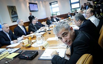 Yair Lapid at the weekly cabinet meeting in Jerusalem, November 30, 2014. (Alex Kolomoisky/Pool/Flash90)