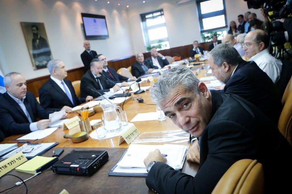 Yair Lapid at the weekly cabinet meeting in Jerusalem, November 30, 2014. (Alex Kolomoisky/Pool/Flash90)