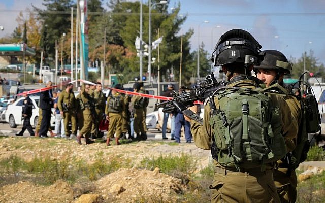 Israeli security forces at Gush Etzion Junction where a young Israeli man was stabbed and lightly injured on December 01, 2014. (Photo credit: Gershon Elinson/FLASH90)