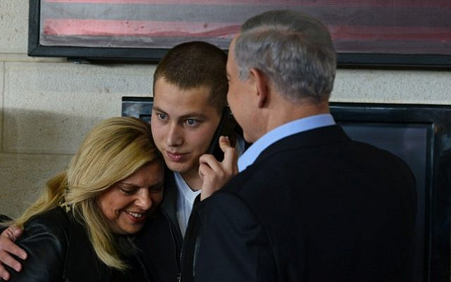Prime Minister Benjamin Netanyahu and his wife Sara, seen with their son Avner (C) as he prepares to begin his IDF service, December 01, 2014. (photo credit: Kobi Gideon/GPO)