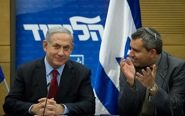 Benjamin Netanyahu (left) with MK Ze'ev Elkin during a Likud faction meeting at the Knesset on December 1, 2014. (Miriam Alster/Flash90)
