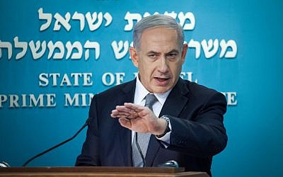 Prime Minister Benjamin Netanyahu addresses the press to announce new elections, Tuesday, December 2, 2014. (photo credit: Emil Salman/POOL)