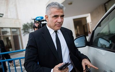 Finance Minister Yair Lapid leaves a financial conference in Jerusalem on December 2, 2014 (photo credit: Yonatan Sindel/Flash90)