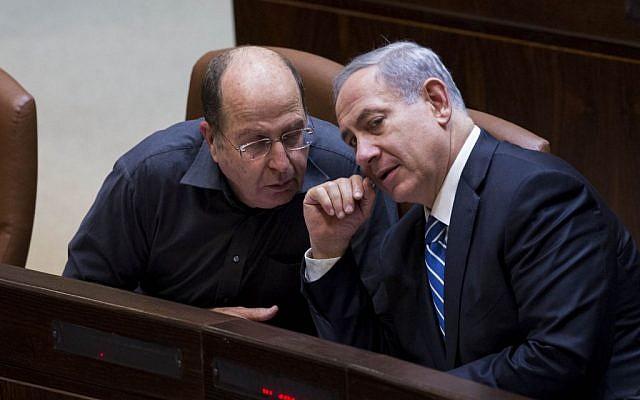Prime Minister Benjamin Netanyahu, right, and Defense Minister Moshe Ya'alon in the Knesset on December 8, 2014. (Photo credit: Yonatan Sindel/Flash90)
