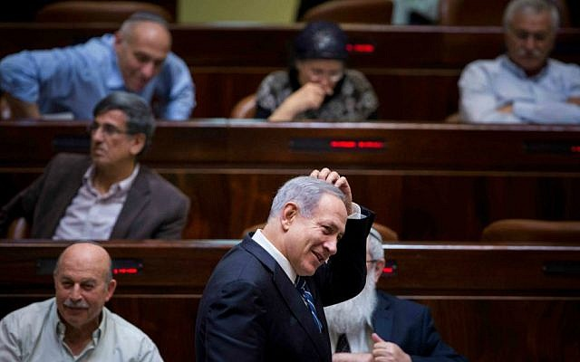 Prime Minister Benjamin Netanyahu in the Knesset during a vote on a bill to dissolve the 19th Knesset, December 8, 2014. (Yonatan Sindel/Flash90)