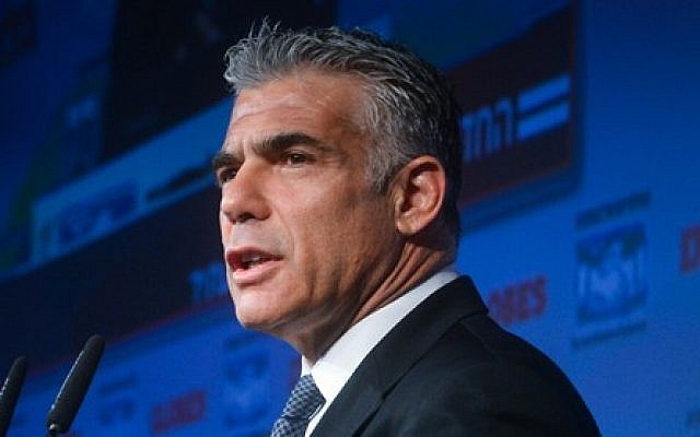 Leader of the Yesh Atid political party Yair Lapid speaks at the opening of the 'Globes Business Conference, in Tel Aviv on December 8, 2014. (photo credit: Flash90)