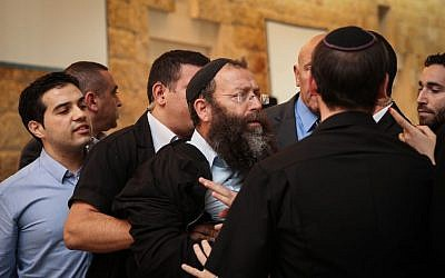 Right wing activist Baruch Marzel clashes with Arab MKs and court security following a court hearing on MK Hanin Zoabi, December 9, 2014 (photo credit: Hadas Parush/Flash90)